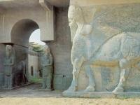 Nimrud_-_Assyria,_Lamassus_Guarding_Palace_Entrance